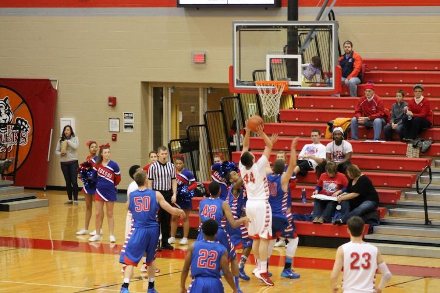Sophomore Cameron Wolter jumps up to dunk the ball. - photo taken by Kristen Shaver