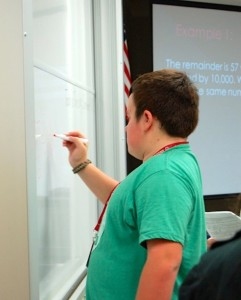 Freshman Matthew Jones writes on the board during an activity for Mrs. Dimos's 2nd period SAT prep class on Sept. 18.
