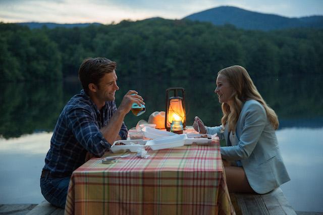 Luke (Scott Eastwood) and Sophia (Britt Robertson) enjoy getting to know each other while dining al fresco in The Longest Ride. (Michael Tackett/Twentieth Century Fox)