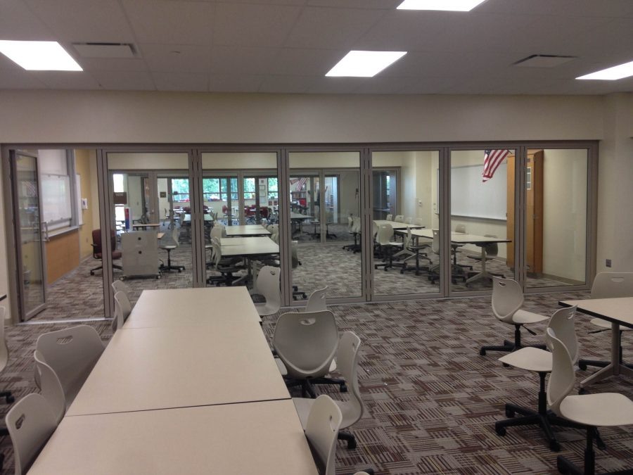 The new facilities have sliding glass doors and new tables and chairs.