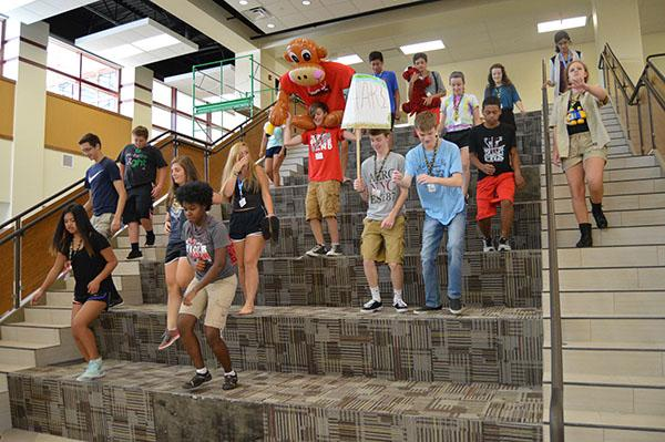 Students play on the gathering stairs in the College and Career Academy during Tiger Fever on July 29. Photo by Jenna Knutson.