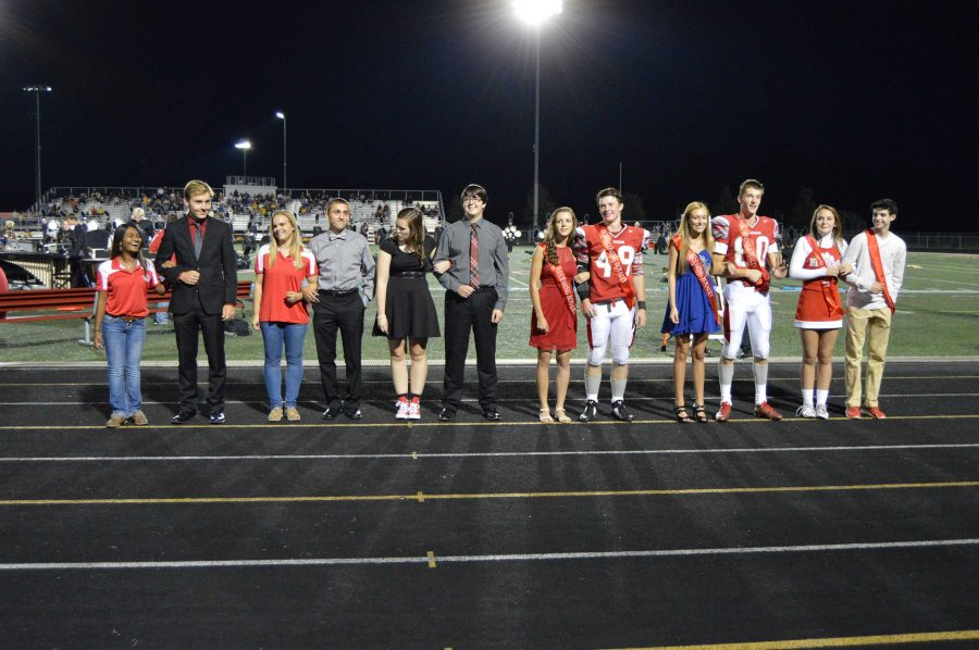 Students of homecoming court receive sashes at football game, Sept. 25.