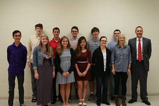 National Merit Semifinalists stand together at the National Merit Breakfast on Sept. 9. Top row left to right: Andy Shingle, Vince Dixon, Josh Levine, Daniel Vance, Gabriel Paree-huf. Bottom row left to right: Matt Ridge, Kendall Gardner, Haley Szilagy, Emily Tong, and Chloe Snipes.