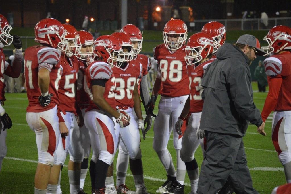 Tigers stand in huddle after Coach Trout talks during game against Cathedral Oct. 2. Tigers lose 35-6.