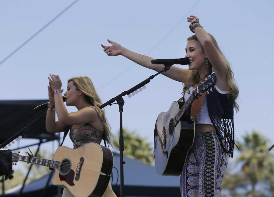 Taylor Dye, left, and Madison Marlow of Maddie & Tae perform on the Mane Stage during the final day of the Stagecoach Country Music Festival on Sunday, April 26, 2015, at the Empire Polo Club in Indio, Calif. (Allen J. Schaben/Los Angeles Times/TNS)