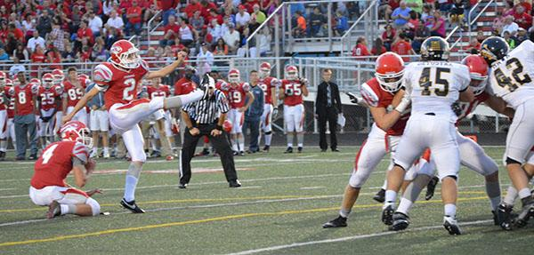 Sophomore Ben Norton punts the ball after another three and out for the Tigers at the homecoming game against Avon on Sept. 25.  FHS lost 36-14.