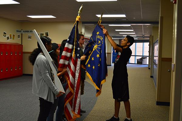 Members of the Armed Forces Club practice presenting the colors during their meeting on Nov. 10.