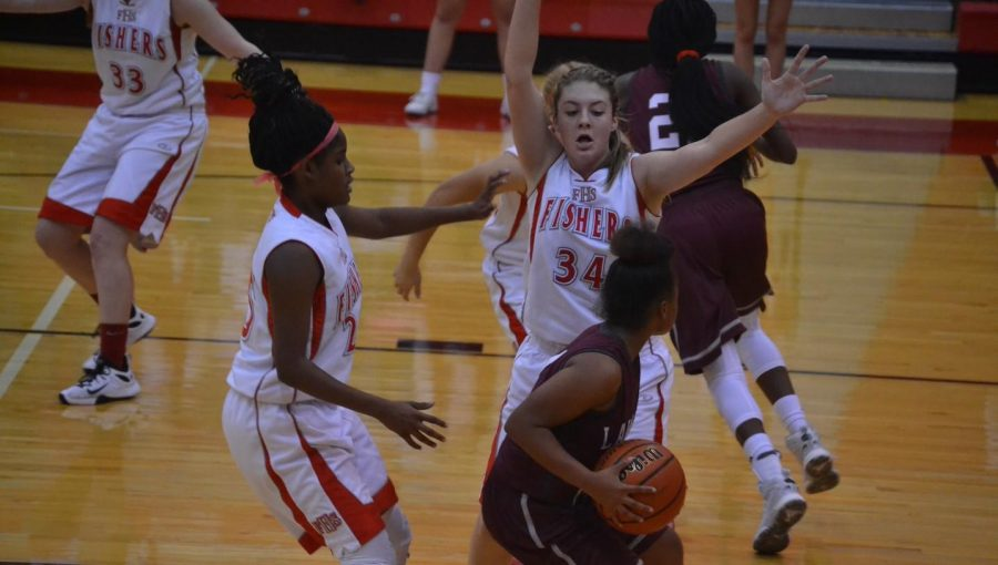 Sophomores Kenedi London and Sydney Rector close out on a Lawrence Central ball handler on Nov. 3. Tigers won, 41-19. Photo by Megan Jessup.
