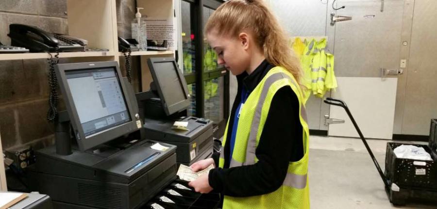 Senior Rachel Titus earns her money at Kroger as a home shopping attendant for Krogers new online shopping program, ClickList, Dec. 15.