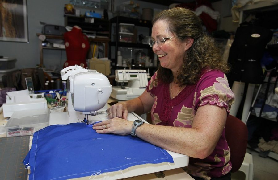 Utilizing her creative skills, a woman uses a sewing machine and fabric to create something. Photo courtesy of MCT Campus