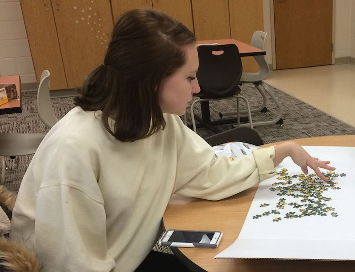 Senior Gabby Goad works on completing Puzzle Clubs second puzzle on Thursday, Jan. 21 in C105. Photo by Madi Calvert