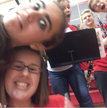 Pep band members gather for a selfie during a performance.