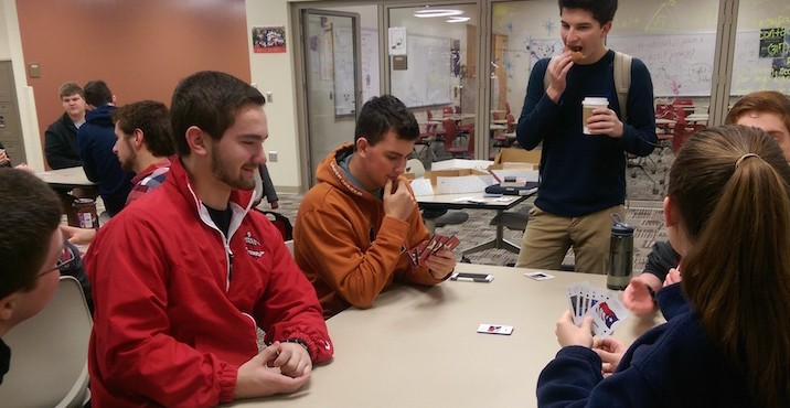 Euchre club members play a game of Euchre before school on Feb. 19.