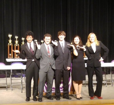 Juniors Matthieu Picard, Noah Alderton, Zane Jud, Olivia Jacobs and Sarah Frisbie accept an award after placing first in the World Debate division at the Indiana State Debate Competition on Saturday, Jan. 30. Photo courtesy of Matthew Rund.