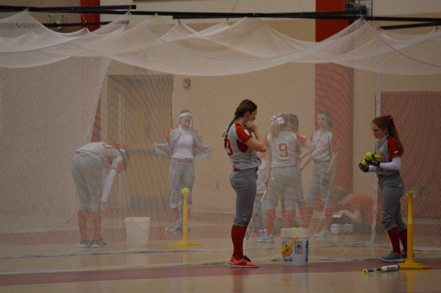 Softball hits in the batting cage before their game in Kokomo on March 21. Photo by Dylan Hughes