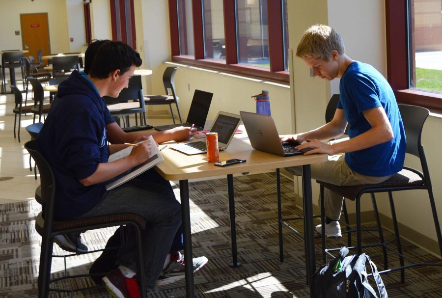 Seniors Connor Mougeotte and Josiah Lillestrand in the CCA as they study for their standardized test. Photo credit Bri Morkal