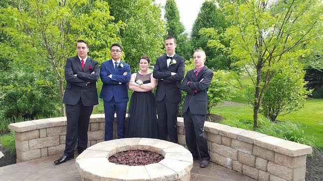 Students pose for prom pictures before the dance on May 7. Photo by Emma Russell.