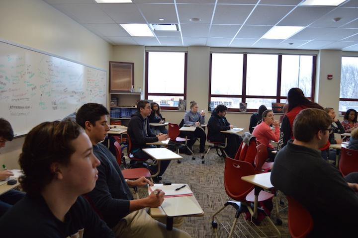 Seniors sit and listen in their first period economics class, a credit required to graduate, with teacher Michael Gaines on January 20.