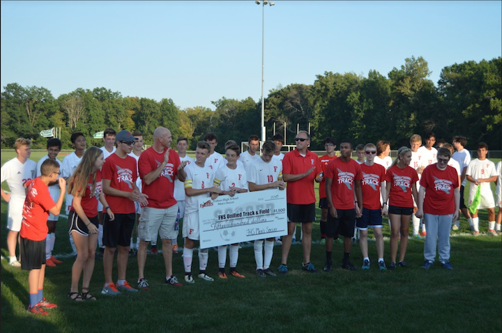 Fishers High School boys soccer raised money and  presented a check to Unified Track and Field team between their games on September 6th. Photo by Alaina Gabbard