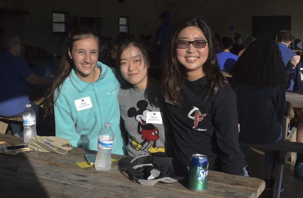 Freshmen Katie Myers, Dania Park, and Rachel Lee eat lunch during their volunteer shifts at Conner Prairie Headless Horseman. Photo by Carolina Puga Mendoza