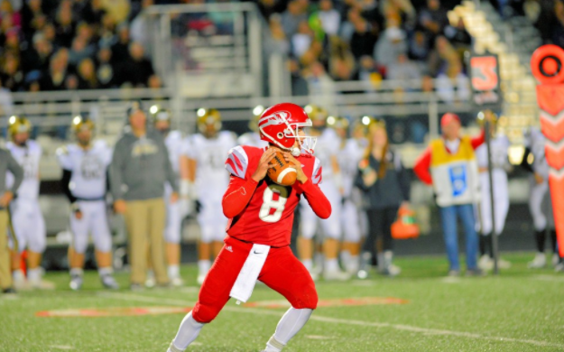 Junior quarterback Matthew Wolff gets ready to throw a pass on Oct. 28 against Noblesville. Tigers win 28-14. Photo courtesy of Fishers High School athletic website.