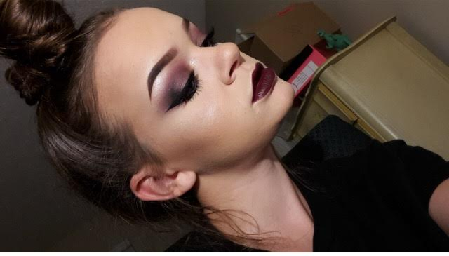 Senior Emily Thompson wears a smokey, wine red eyeshadow look with contouring and highlighting her face. Photo used with permission of Emily Thompson.