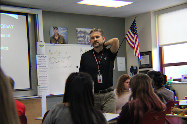 English teacher Phillip Albonetti discusses information about the SAT to his after school SAT Prep class. Photo by Mandy Lewellen.