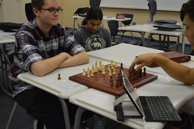 Chess club members Noah Brandt and freshman Peyton Forbes play a game of chess. Photo by Hallie Gallinat