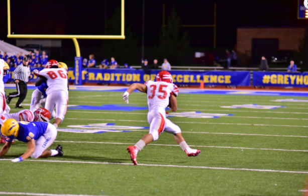 Junior running back Michael Noble runs the ball towards the end zone on Nov. 4 against Carmel. Tigers loose 23-10. Photo used with permission of Fishers High School athletic website.