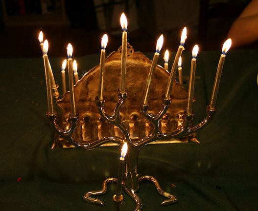 The Menorah is used during Hanukkah to represent the eight nights where they thought they would run out of oil for their lamps and be in darkness.  Photo courtesy of Scott. https://creativecommons.org/licenses/by-sa/2.0/