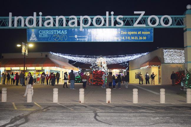 The entrance to the zoo was full of Santas helpers. They would stamp your hand and take photos with the children. After that they would lead you to the green house to go visit Santa. Photo by Alaina Gabbard.