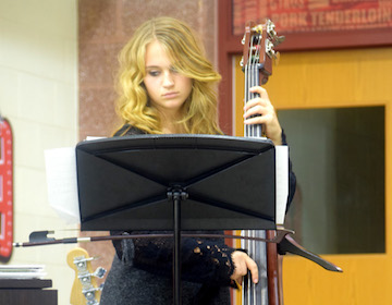Sophomore Jenna Burow plays the bass for a piece at the jazz band concert on Nov. 18. Photo by Megan Jessup.