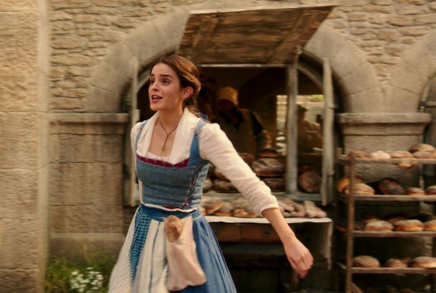 In the new live-action Beauty and the Beast Belle, played by Emma Watson, skips through town as she sings about wanting more than a simple provincial life. Photo used with permission of Tribune News Service.