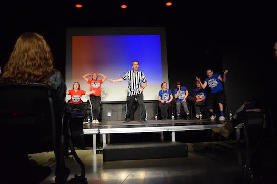 Comedy Sportz sponsor Jon Colby referees a match on Jan. 26. Photo by Jenna Knutson.