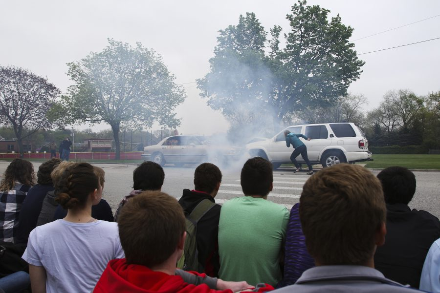 High school seniors watch a drunk driving crash simulation in Hinsdale, Ill., on April 27, 2016. Photo used with permission from Tribune News Service.