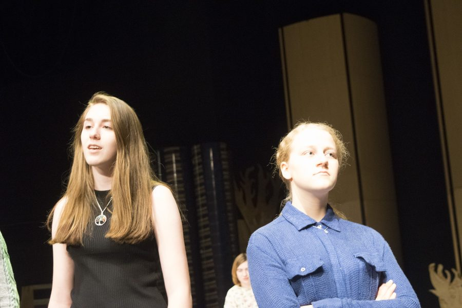 Junior Abagail Zagel, playing Hermia, and sophomore Lexi Esterle, playing Helen, argue over the trick played on them by the fairy Puck. Photo by Mo Wood.