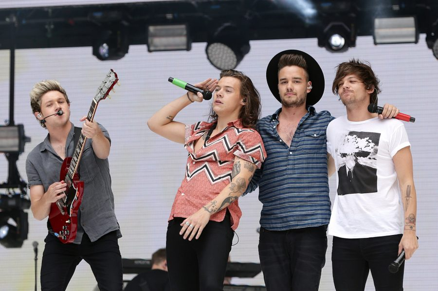 Artist Harry Styles performing with previous One Direction band members at Wembley Stadium in London. Photo used with permission of MCT Campus.