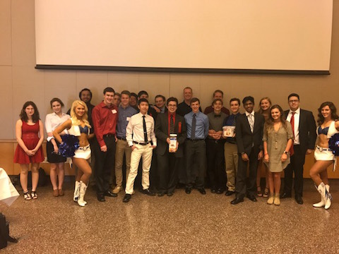 The economics team poses poses with two Indianapolis Colts cheerleaders after its state competition on April 13, 2017.
