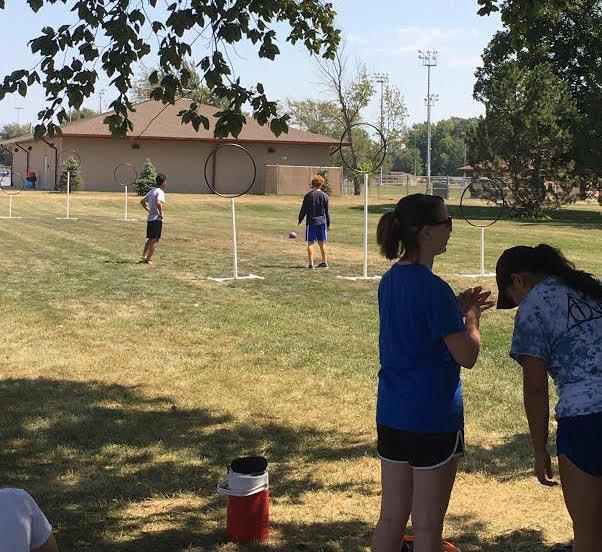Players+practice+their+Quidditch+skills+before+the+game+begins.++Photo+by+Hallie+Gallinat.