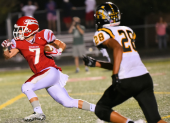 Junior wide receiver Colin Statz runs ball towards the end zone and away from Avon defense on September 22. Tigers win 35-28. Photo courtesy of Fishers High School athletic website.