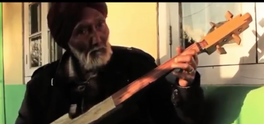 A musician from the Meghalaya region of India plays a folk song.