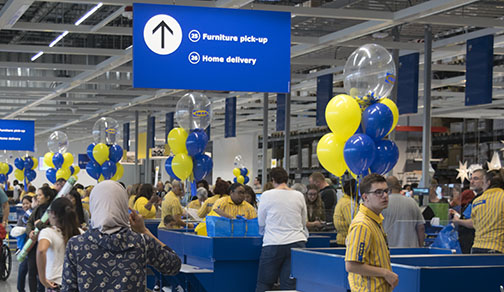 IKEA customers stand in line to purchase furniture and items they found to their liking on Oct. 11, IKEAs opening day. Photo by John Yun