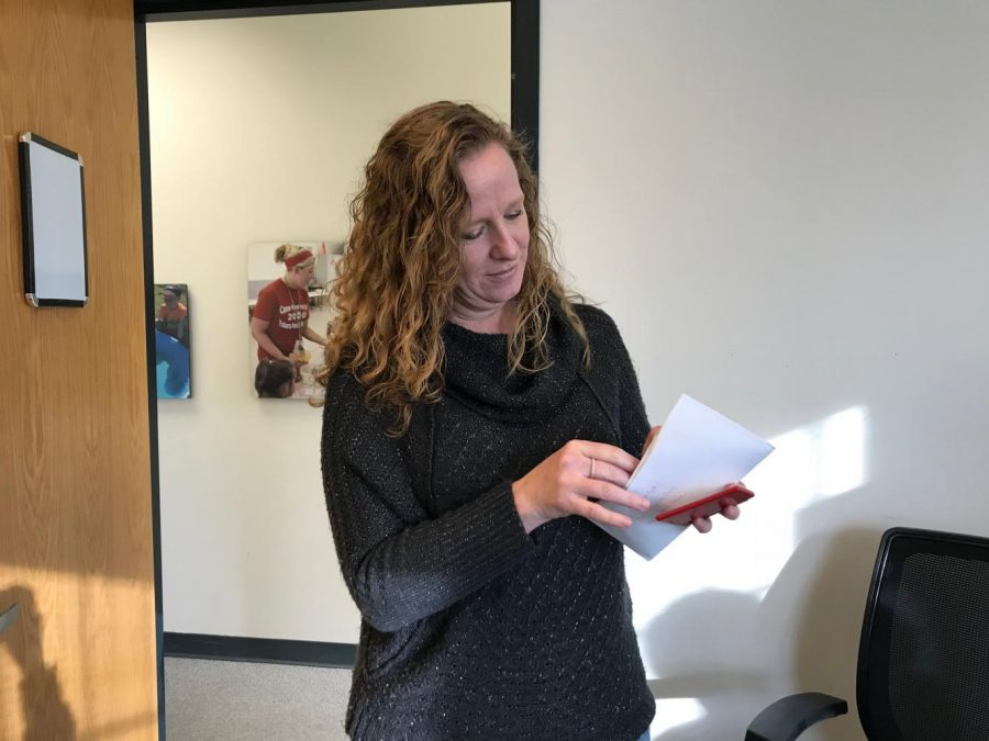 Andrea Babb reviews a letter from Santas Mailbox on Nov. 17 at the Parks and Recreation Office.  Photo by Sydney Greenwood.