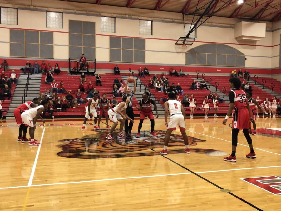 Tigers tip off against Indianapolis Emmerich Manual on Nov. 27. FHS won 64-50. Photo courtesy of Fishers High School athletic website.