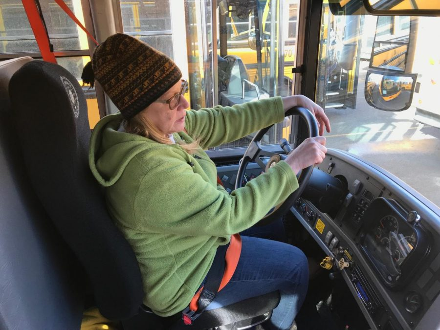 Bus driver Robin Rodriguez waits in the parking lot for her students so that she can take them home on Jan. 19. Robin Rodriguez is one of 303 staff members of the transportation department. Photo by John Yun.