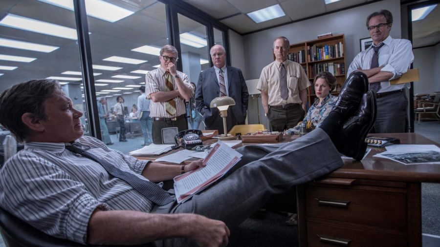 Tom Hanks as Ben Bradlee, David Cross as  Howard Simons, John Rue as Gene Patterson, Bob Odenkirk as Ben Bagdikian, Jessie Mueller as Judith Martin and Philip Casnoff as Chalmers Roberts  discuss the gravity of publishing top secret documents such as The Pentagon Papers in July of 1971. Photo used with permission of Tribune News Service.