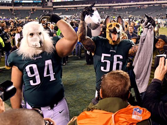 Eagles' defensive players Beau Allen and Chris Long celebrate the victory of the NFC Championship by wearing dog masks to symbolize the underdog status that they have been riding on all playoffs. Photo used with permission of BipHoo Company.