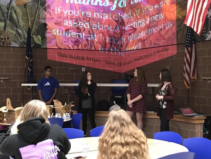 Juniors Isaac Jones, Hollyn Weideman, Claire Blake, and Martha Van Valer tell Tiger Ambassadors Club members about volunteer opportunities on Feb. 13. Photo by Sydney Greenwood.
