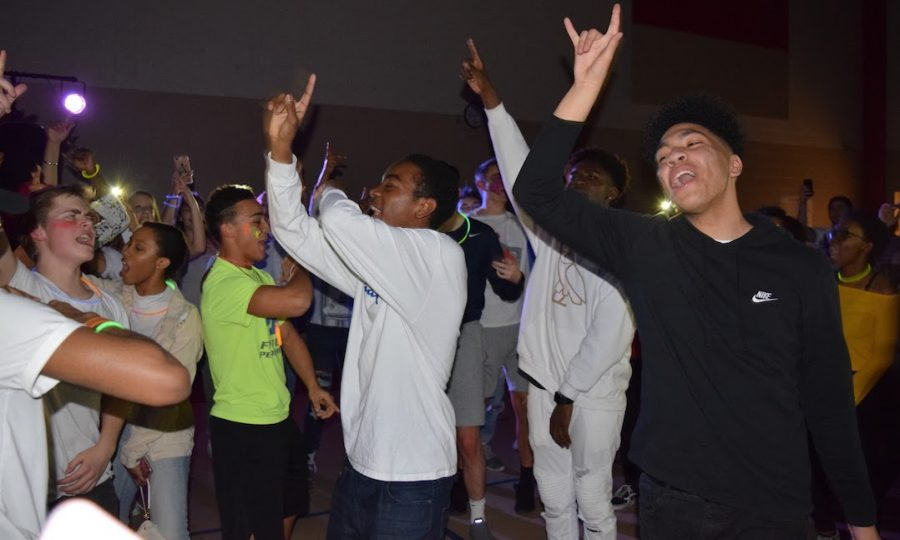 """All the students follow Iseghohi and sophomore Cameron White,  jumping and throw their hands to the air while yelling, """"I only love my bed and my momma, I'm sorry, a famous line in Drake's newest hit """"God's Plan. Photo by John Yun."""