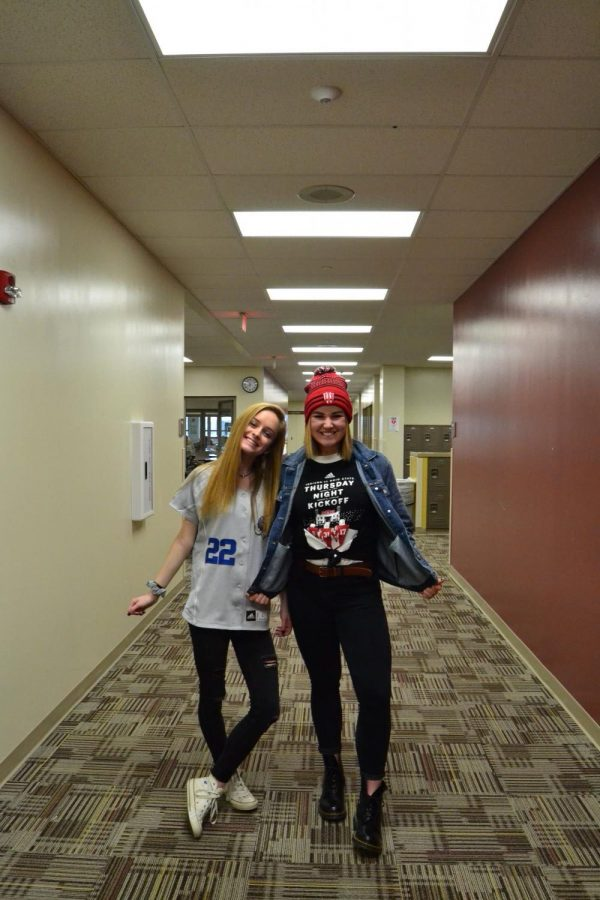 On College/Jersey day, seniors Makayla Pruett and London Osmun smile wide as they wear their spirit wear. Osmun dressed in an Indiana University beanie and an Indiana University basketball teeshirt while Pruett wore an Indiana University Fort Wayne Mastodons baseball jersey on Monday, March 12. Photo by Sawyer Osmun.